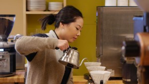 Woman pouring coffee.