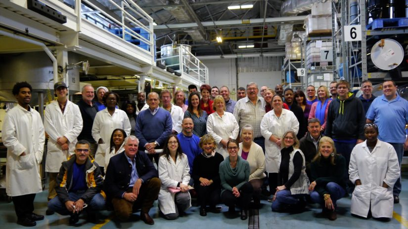 Group photo of employees in a factory.